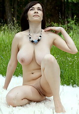 this model is a warm sole who has big eyes and soft voice, she also has enormous boobs that are quite heavy : Katy C